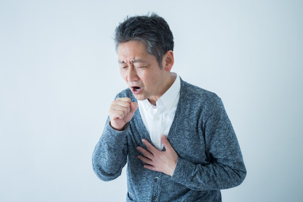 shutterstock_1052037224_coughing